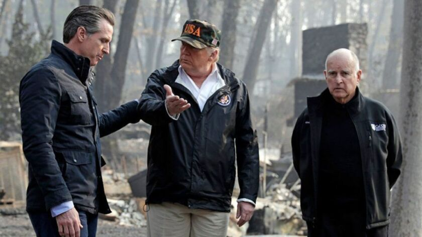 President Trump talks with then-Gov.-elect Gavin Newsom as then-Gov. Jerry Brown listens during a visit Nov. 17 to a neighborhood in Paradise destroyed in the Camp fire.