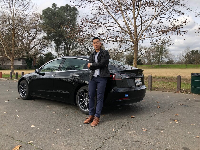 Ethan Dang and his 2019 Tesla Model 3.