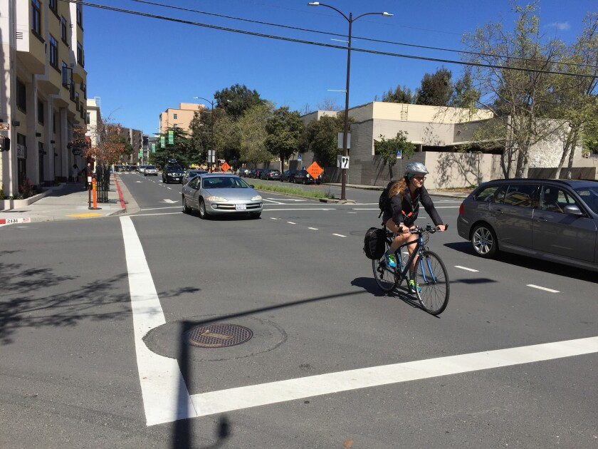 A cyclist rides along Fulton Street in Berkeley in March 2016.