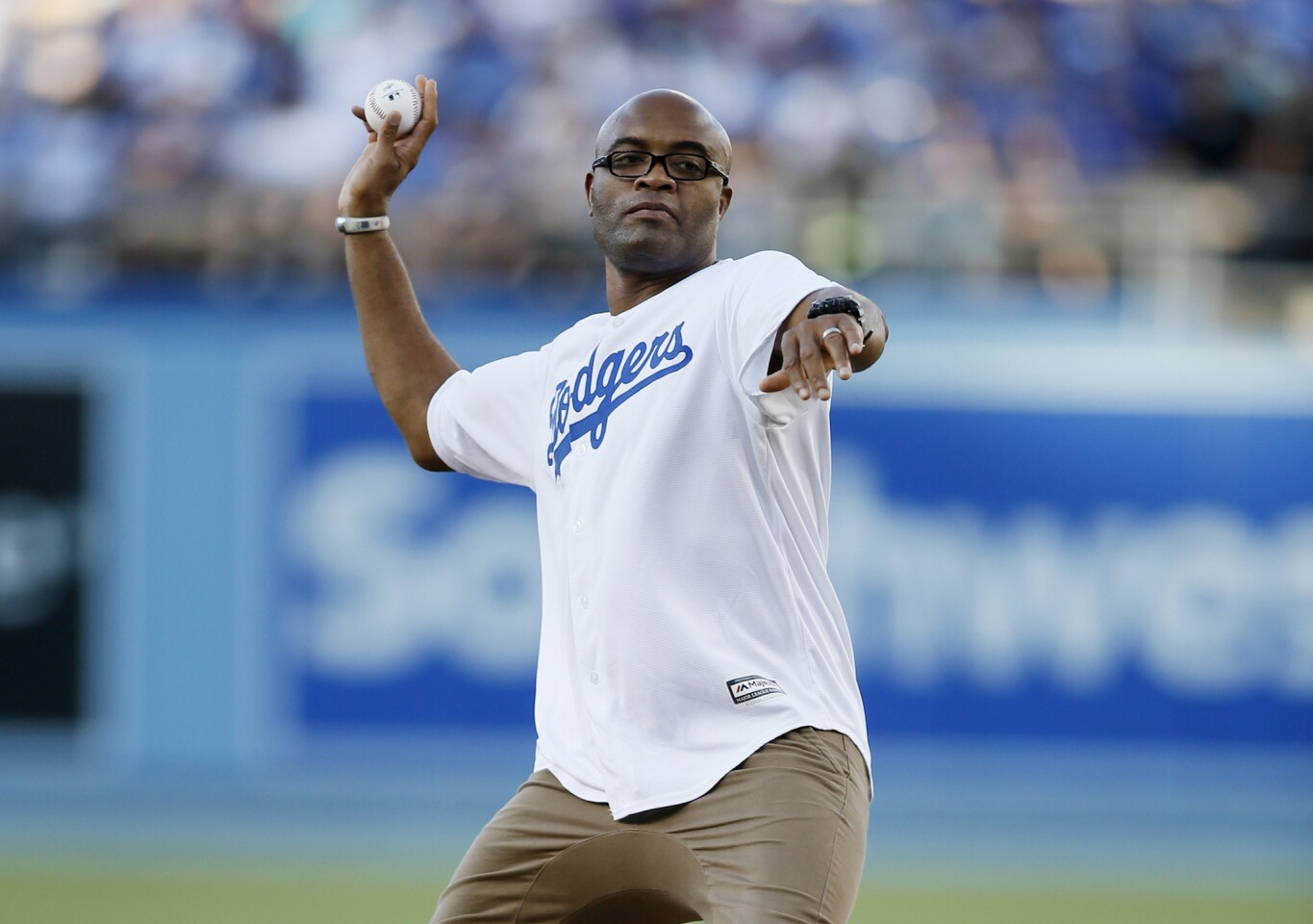 Mixed martial artist and former UFC fighter Anderson Silva throws out a ceremonial first pitch before the baseball game between the Los Angeles Dodgers and Milwaukee Brewers, Saturday, July 11, 2015, in Los Angeles. (AP Photo/Danny Moloshok)