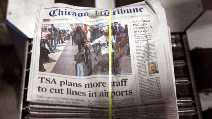 A bundle of Chicago Tribune newspapers comes off the press in 2016.