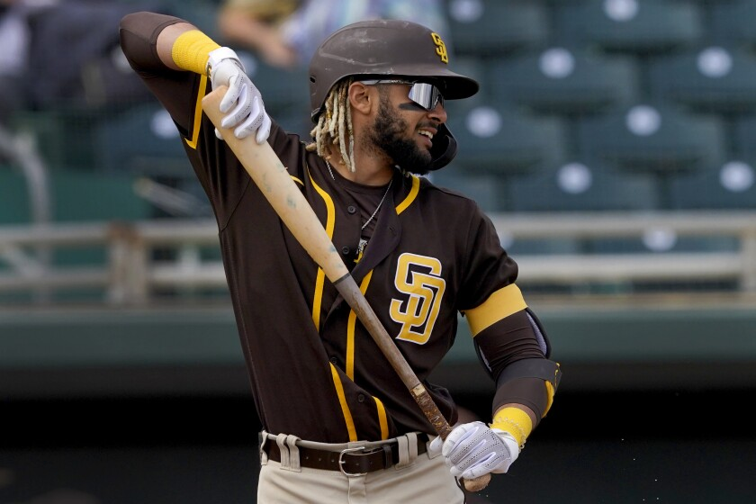 San Diego Padres' Fernando Tatis Jr. stretches in the batter's box during the first inning of a spring training baseball game against the Oakland Athletics, Friday, March 12, 2021, in Mesa, Ariz. (AP Photo/Matt York)