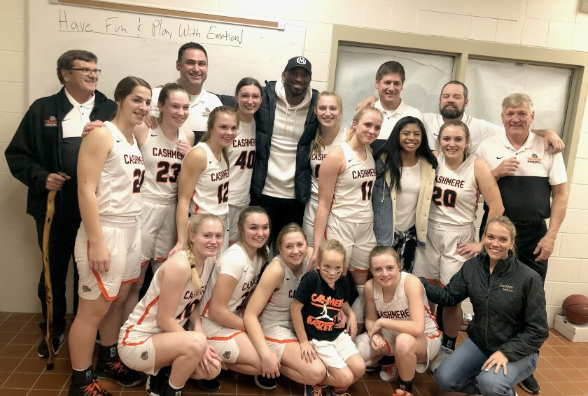 Kobe and Gianna Bryant pose with the Cashmere High School girls' varsity team on Jan. 11.