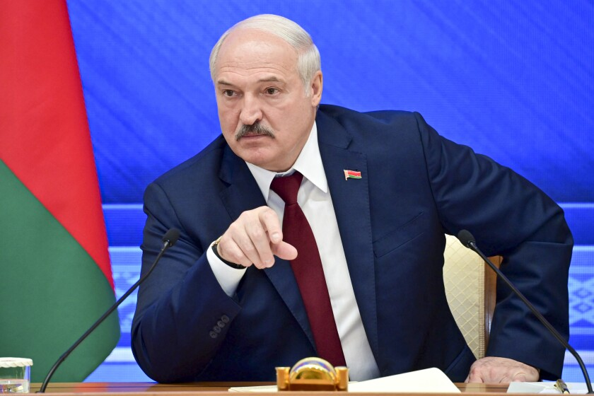 FILE - In this Monday, Aug. 9, 2021 file photo, Belarusian President Alexander Lukashenko gestures while speaking during an annual press conference in Minsk, Belarus. The authoritarian leader of Belarus said Wednesday Sept. 1, 2021, that the country will soon receive a large batch of Russian weapons, including dozens of combat jets, helicopters and top-of-the-line air defense missile systems. (Andrei Stasevich /BelTA photo via AP, File)