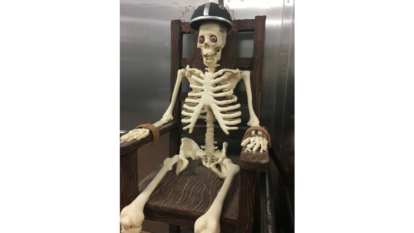 A life-size skeleton sits in an electric chair at Jean-Philippe Patisserie at Aria. Crafted from chocolate, both are part of the shop's amazing Halloween display.