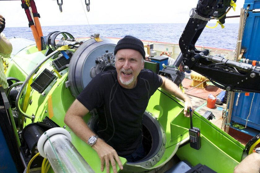 """FILE - This 2012 file photo released by National Geographic shows filmmaker James Cameron emerging from the Deepsea Challenger after his successful solo dive to the Mariana Trench, during the filming of Cameron's """"Deepsea Challenge 3D,"""" a 3-D film releasing on Friday, Aug. 8, 2014. It has been five years since Cameron's last feature film, """"Avatar.""""(AP Photo/National Geographic, Mark Thiessen, File)"""