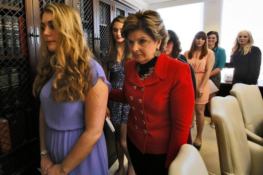 Attorney Gloria Allred, right, escorts six current or former Occidental College students after filing a civil rights complaint outlining alleged violations of Title IX, which bars sex discrimination at schools.