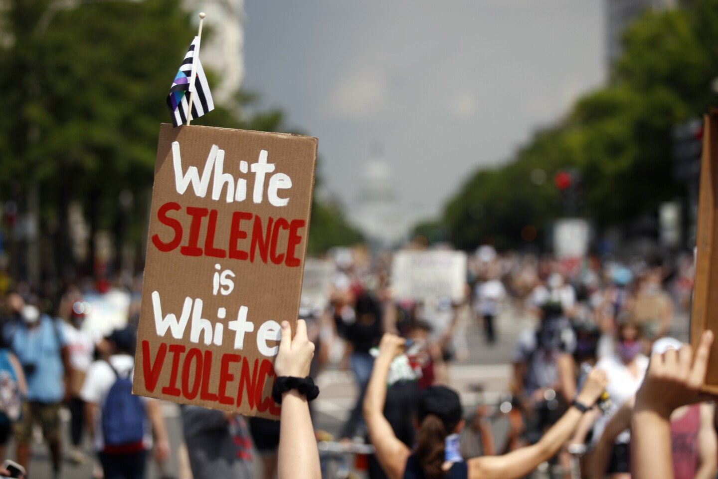 Demonstrators protest, Saturday, June 6, 2020, in Washington, over the death of George Floyd, a black man who was in police custody in Minneapolis. Floyd died after being restrained by Minneapolis police officers. (AP Photo/Andrew Harnik)