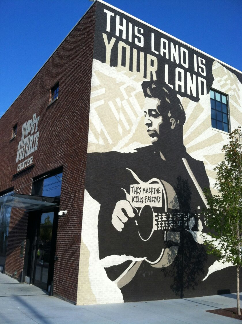 This Sept. 26, 2014 photo shows the Woody Guthrie Center in Tulsa, Oklahoma's Brady Arts District. Guthrie was an Oklahoma native and the center honors his life and legacy. You'll have to pay to visit the museum but the evocative mural outside lends a distinctive feel to the neighborhood. The Brady