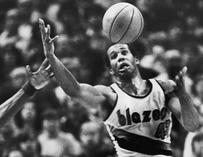 Kermit Washington, pictured as a member of the Trail Blazers, grabs a loose ball during a game against the Warriors on Dec. 25, 1979.