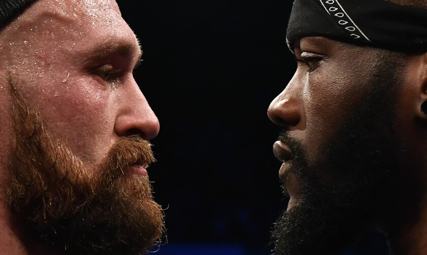 BELFAST, NORTHERN IRELAND - AUGUST 18: Tyson Fury is confronted by rival boxer Deontay Wilder after defeating Francesco Pianeta in a heavyweight contest at Windsor Park on August 18, 2018 in Belfast, Northern Ireland. (Photo by Charles McQuillan/Getty Images) ** OUTS - ELSENT, FPG, CM - OUTS * NM, PH, VA if sourced by CT, LA or MoD **