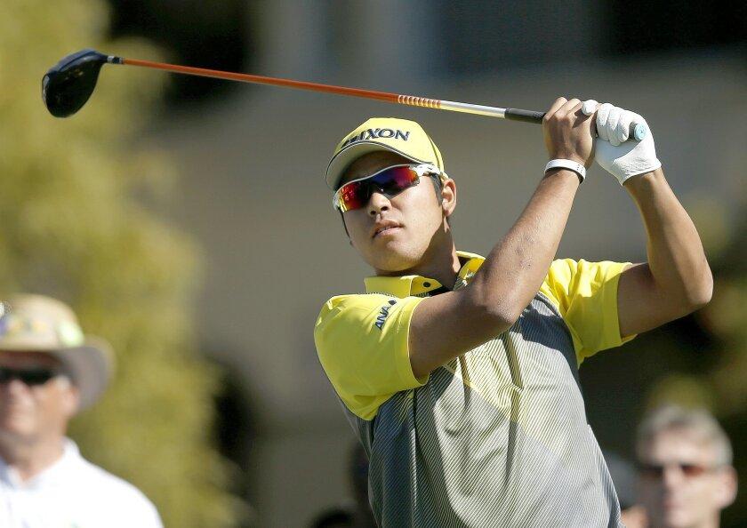Hideki Matsuyama of Japan, tees off on the fifth hole during the final round of the Phoenix Open golf tournament, Sunday, Feb. 7, 2016, in Scottsdale, Ariz. (AP Photo/Rick Scuteri)