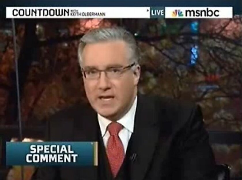 """This frame grab image taken from MSNBC video shows anchorman Keith Olbermann delivering a special comment during the """"Countdown with Keith Olbermann"""" show, Oct. 27, 2010. MSNBC has suspended Olbermann indefinitely without pay for contributing to the campaigns of three Democratic candidates this election season. Olbermann acknowledged to NBC that he donated $2,400 apiece to the campaigns of Kentucky Senate candidate Jack Conway and Arizona Reps. Raul Grivalva and Gabrielle Giffords. (AP Photo/MSNBC)"""
