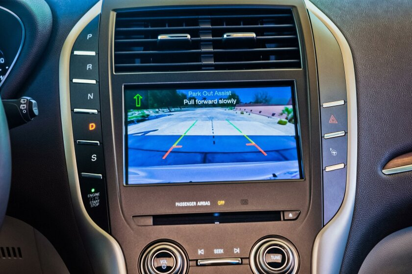 Park out assist uses sensors to guide drivers out of tight parallel- parking spots.
