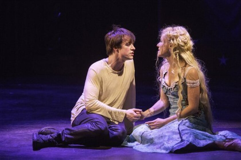 """This undated publicity photo provided by American Repertory Theater shows Matthew James Thomas, left, as Pippin and Rachel Bay Jones as Catherine in a production of """"Pippin,"""" at the American Repertory Theater in Cambridge, Mass. (AP Photo/American Repertory Theater, Michael J. Lutch)"""