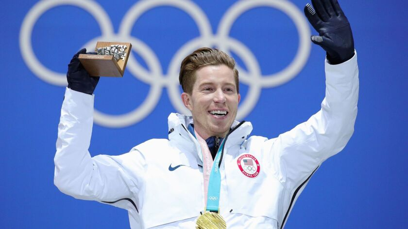 U.S. snowboarder Shaun White celebrates his gold medal victory Thursday at the Winter Olympics in Pyeongchang, South Korea. NBC offered live video of his victory on Snapchat, the social media app.