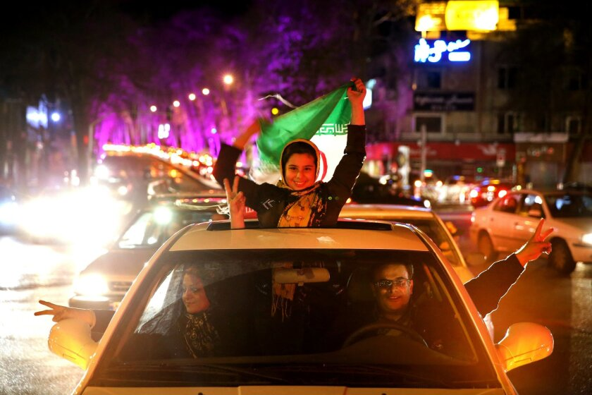 Iranians celebrate on a street in northern Tehran, Iran, Thursday, April 2, 2015, after Iran's nuclear agreement with world powers in Lausanne, Switzerland. Iran and six world powers reached a preliminary nuclear agreement Thursday outlining commitments by both sides as they work for a comprehensive deal aiming at curbing nuclear activities Tehran could use to make weapons and providing sanctions relief for Iran. (AP Photo/Ebrahim Noroozi)