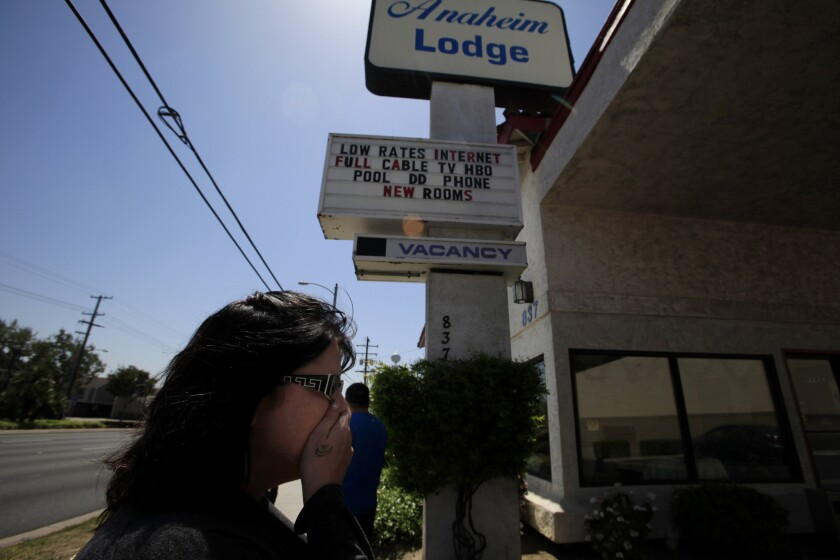 Jodi Estepp in April at an Anaheim motel where her daughter Jarrae Estepp, 21, had stayed before she was slain. Police think Franc Cano and Steven Gordon, both registered sex offenders, killed her and three other women.