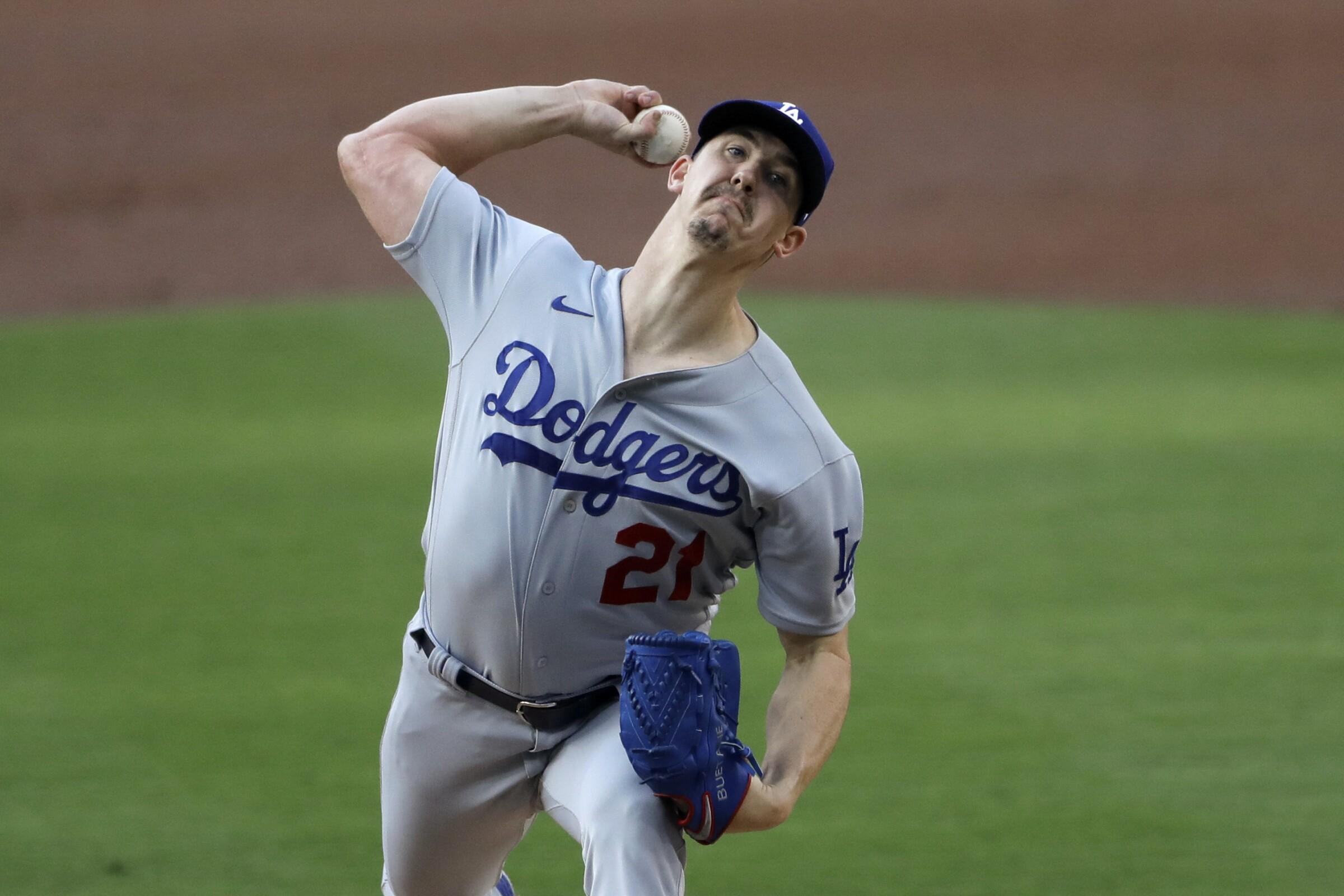 Los Angeles Dodgers starting pitcher Walker Buehler works against a San Diego Padres batter.
