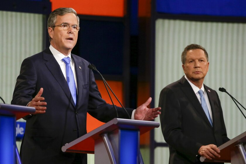 Republican presidential candidate former Florida Gov. Jeb Bush answers a question as Ohio Gov. John Kasich listens during a Republican presidential primary debate, Thursday, Jan. 28, 2016, in Des Moines, Iowa. (AP Photo/Charlie Neibergall)