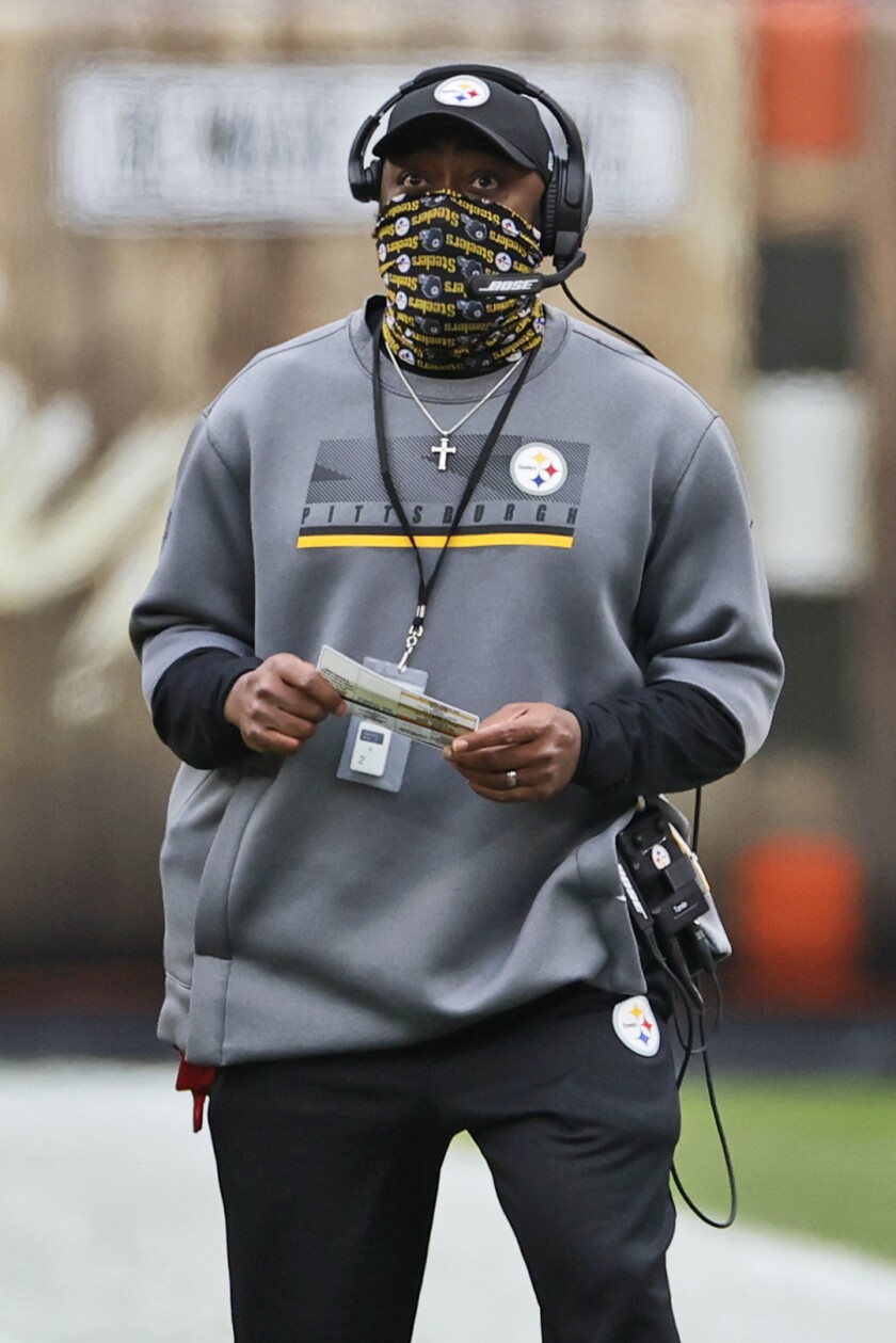 Pittsburgh Steelers head coach Mike Tomlin watches during the first half of an NFL football game against the Cleveland Browns, Sunday, Jan. 3, 2021, in Cleveland. (AP Photo/Ron Schwane)