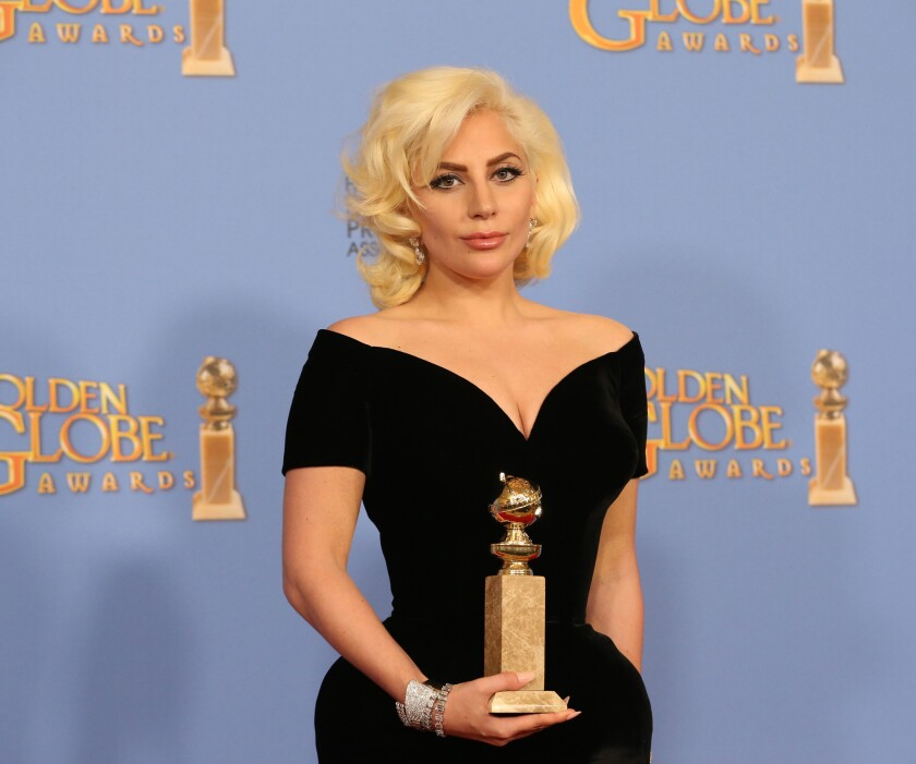 Lady Gaga poses with her Golden Globe at the Beverly Hilton Hotel on Jan. 10.