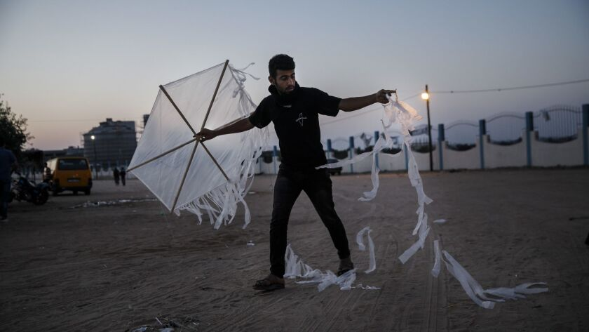 DEIR AL-BALA, GAZA STRIP -- WEDNESDAY, MAY 9, 2018: A Palestinian protester readies his kite that ca