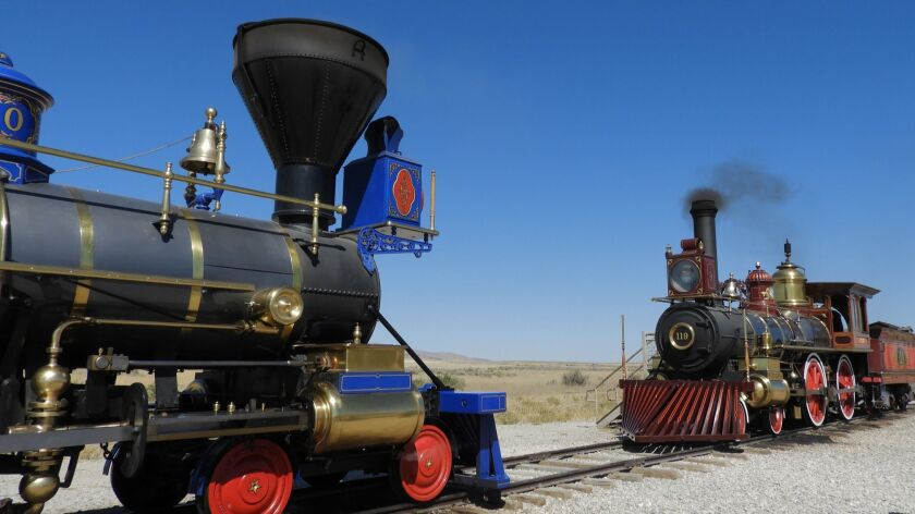 "Replicas of the Central Pacific's ""Jupiter"" and the Union Pacific's ""No. 119"" come to a stop within"