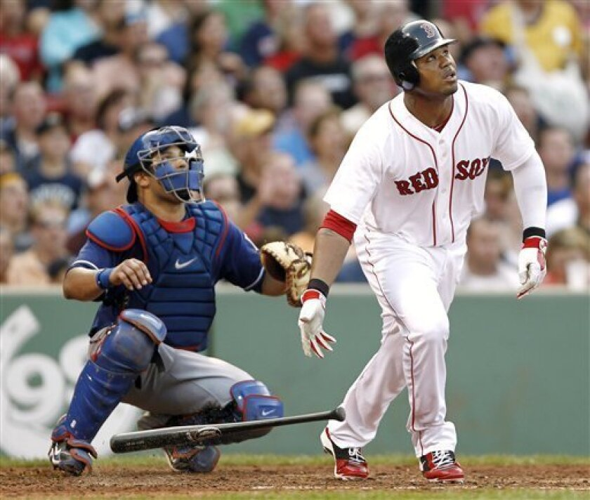 Boston Red Sox's Carl Crawford, right, and Texas Rangers catcher Yorvit Torrealba watch Crawford's grand slam during the fourth inning of a baseball game at Fenway Park in Boston, Saturday, Sept. 3, 2011. (AP Photo/Winslow Townson)