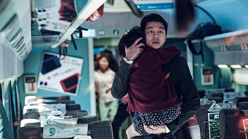 "A scene from the movie ""Train to Busan,"" as a father and daughter try to save themselves from zombies rampaging on a train in South Korea."