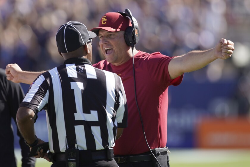 Southern California head coach Clay Helton argues with an official in the second half of an NCAA college football game against BYU, Saturday, Sept. 14, 2019, in Provo, Utah. BYU defeated USC 30-27. (AP Photo/George Frey)