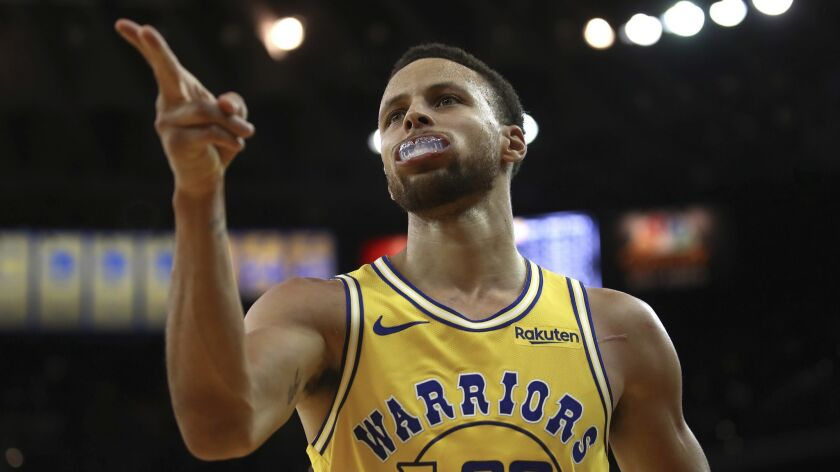 The Golden State Warriors' Stephen Curry celebrates a score against the Washington Wizards during their Oct. 24 game in Oakland.