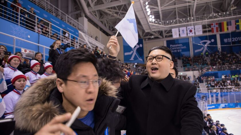 South Korean security guards remove a man impersonating North Korean leader Kim Jong Un from the Unified Korean ice hockey game against Japan in Gangneung, South Korea, on Feb. 14.