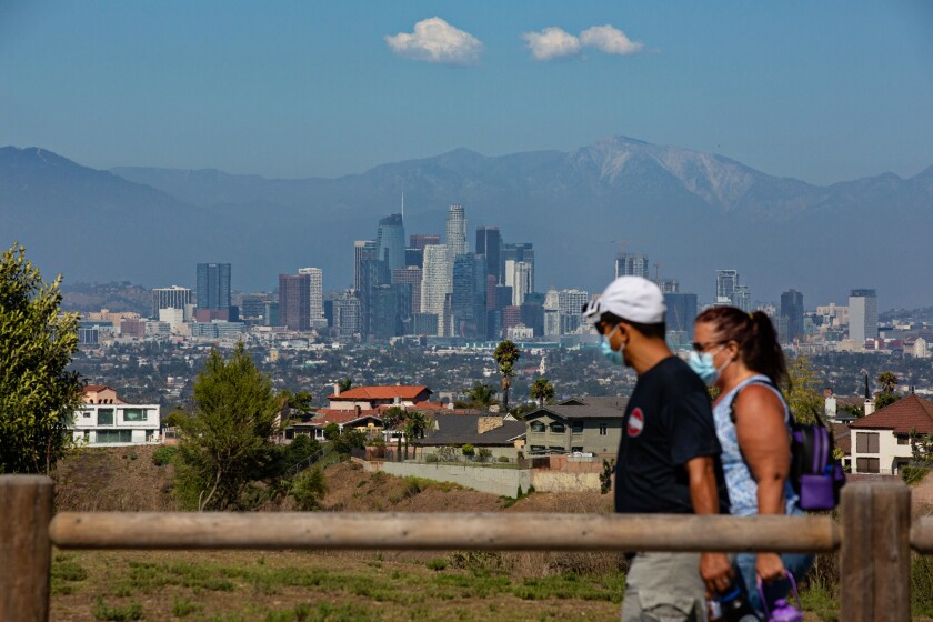 People enjoy a hike at the Kenneth Hahn State Recreation Area in Los Angeles on Aug. 8.