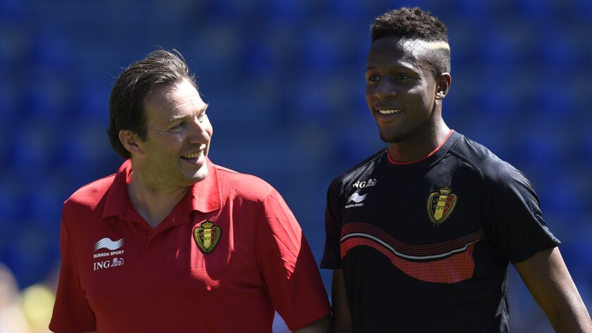 Belgium Coach Marc Wilmots, left, speaks with Belgian striker Origi Divock during a training session on May 20. The youthful Belgian World Cup squad is hoping to usher in a new golden age for the country in international soccer.