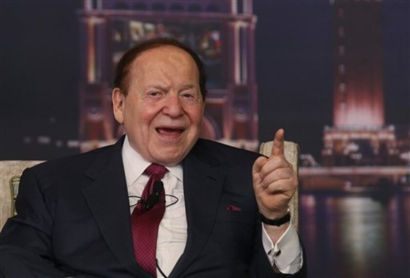 Las Vegas Sands Chairman and CEO Sheldon Adelson speaks at a news conference for the Sands Cotai Central in Macau Wednesday, April 12, 2012. U.S. billionaire Adelson's Macau casino operator launched on Wednesday its long-delayed fourth resort, a $4.4-billion complex that's the company's latest bet on continued strong growth in the world's biggest gambling market. (AP Photo/Kin Cheung)