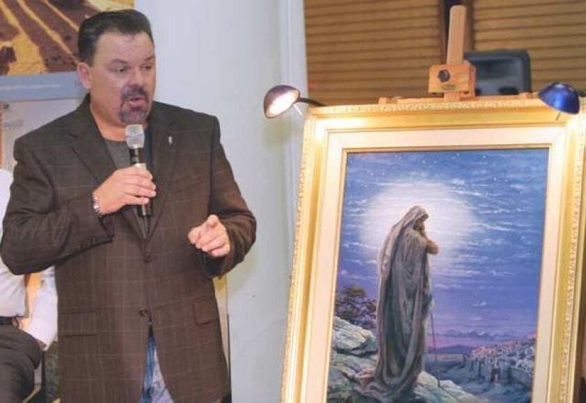 """Thomas Kinkade, with his painting """"Prayer for Peace,"""" in 2006. He died in April at age 54."""