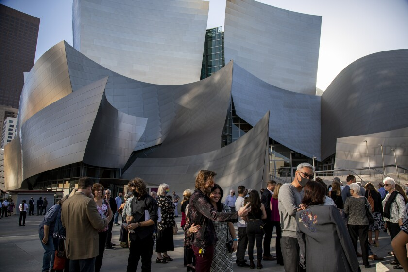 LOS ANGELES, CA - JUNE 26, 2021: Invited guests wait in line outside the Walt Disney Concert Hall to pick up their tickets for the Los Angeles Chamber Orchestra's first public concert since the lockdown on June 26, 2021 in Los Angeles, CA.(Gina Ferazzi / Los Angeles Times)