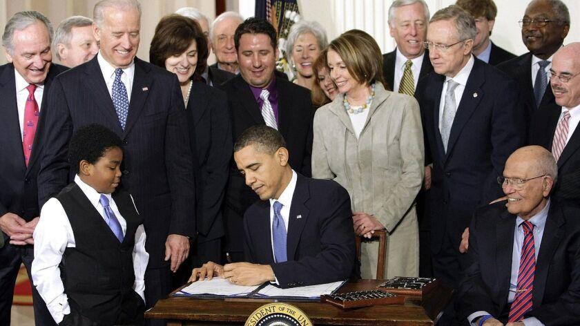President Obama signs the Affordable Care Act in March 2010.