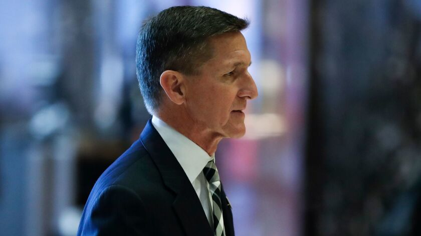 Michael Flynn, President Trump's former national security advisor, walks through the lobby at Trump Tower in New York in 2016.