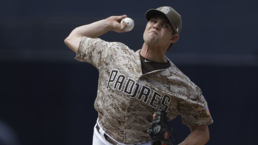 San Diego Padres relief pitcher Robert Stock works against an Arizona Diamondbacks batter during the