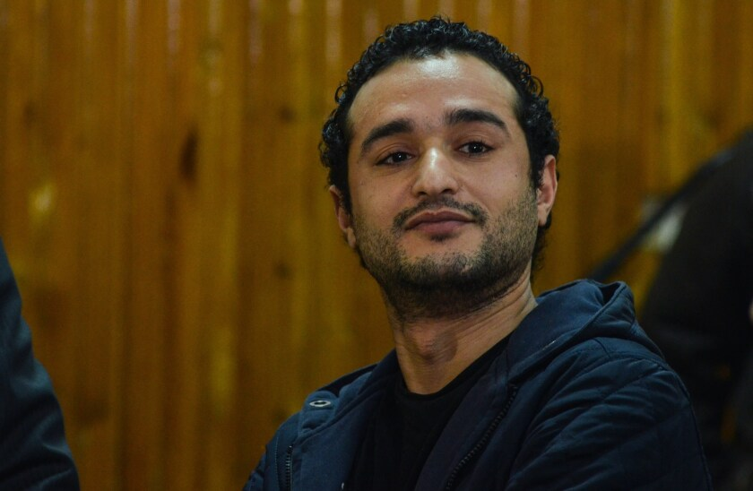Egyptian opposition campaigner Ahmed Douma listens Feb. 4 as a court imposes a sentence of life in prison on him and 229 other people.