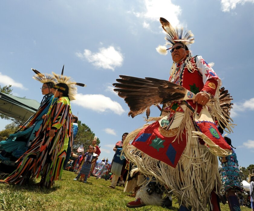 Photo by John Koster /  Native Americans dance during intertribal and competitive gourd dancing at the 15th annual pow wow hosted by the San Luis Rey band of Luiseno Indians on the grounds of the Mission San Luis Rey. The Pow Wow includes parades, dancing, art and food booths and music.