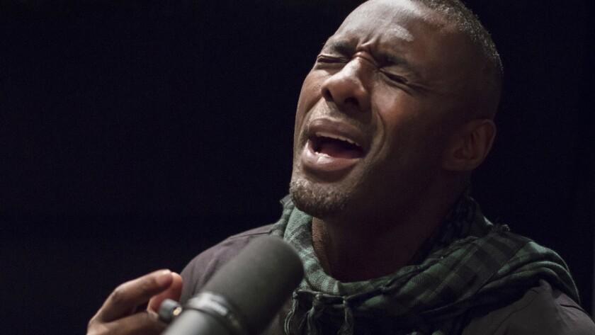 LOS ANGELES, CALIFORNIA - MAR. 1, 2019: British actor Idris Elba records lyrics while he works on cr