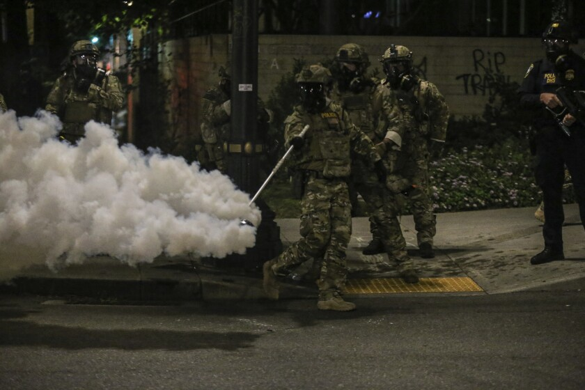 Militarized federal agents deployed by the president to Portland, Ore., in July fired tear gas against protesters.