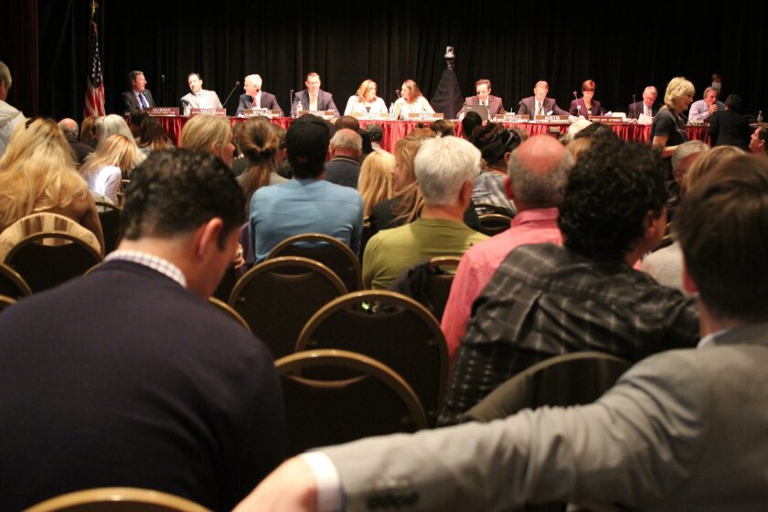 Several hundred people attend the Dec. 4 public hearing on the potential regulation of short-term vacation rentals in residential neighborhoods.