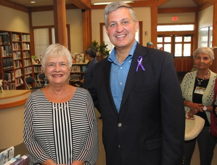 Friends of the Library Board President Pat Freeman with County Supervisor Dave Roberts in November.