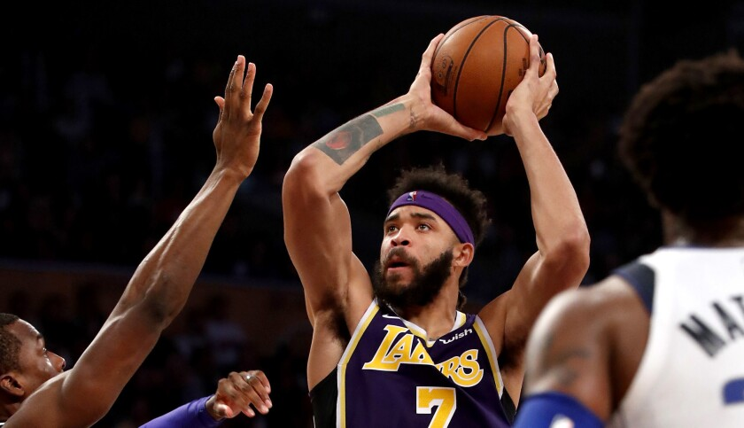 LOS ANGELES, CALIF. - OCT. 31, 2018. Lakers center Javale McGee goes to the basket against the Maver