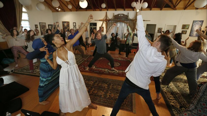 VENICE, CA.-MARCH 8, 2015: Matthew Cohen, center, a Qigong teacher, leads the group in energy cultiv