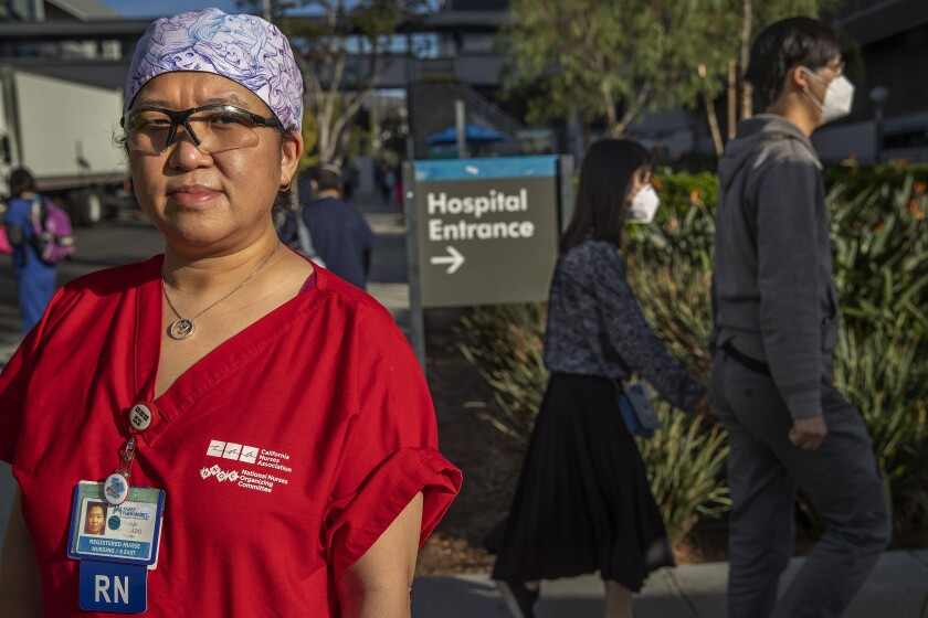 LOS ANGELES, CA - NOVEMBER 20, 2020: Tinny Abogado, 46, a registered nurse at Kaiser Permanente Medical Center on Sunset Blvd in Los Angeles, is photographed outside the hospital, where she has worked for over 20 years. There are concerns in the CA health care system as the third COVID wave crashes over the state. (Mel Melcon / Los Angeles Times)